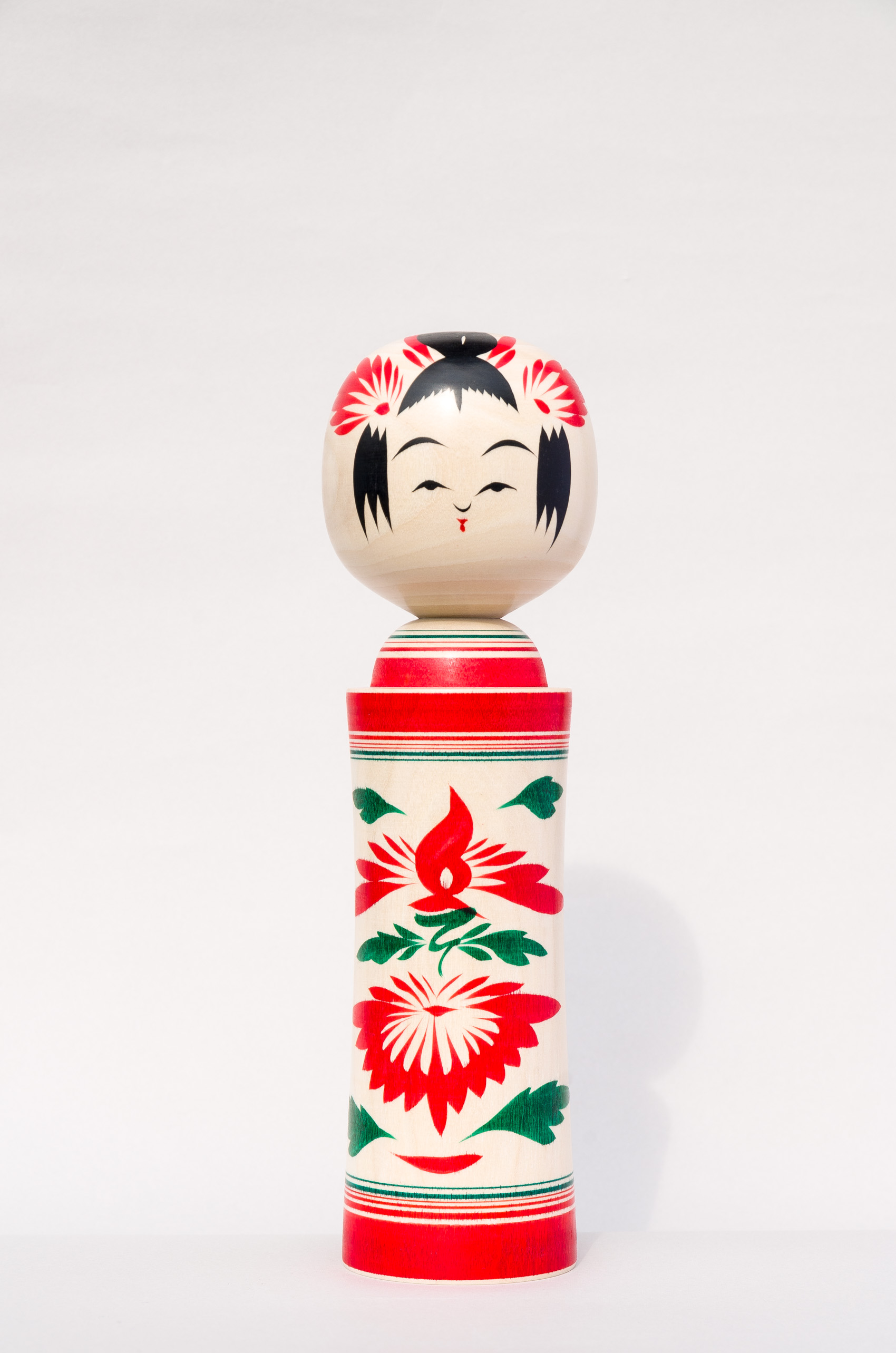 Kokeshi from Japans Tohoku region are at Japan House London. Image by TOHOKU STANDARD