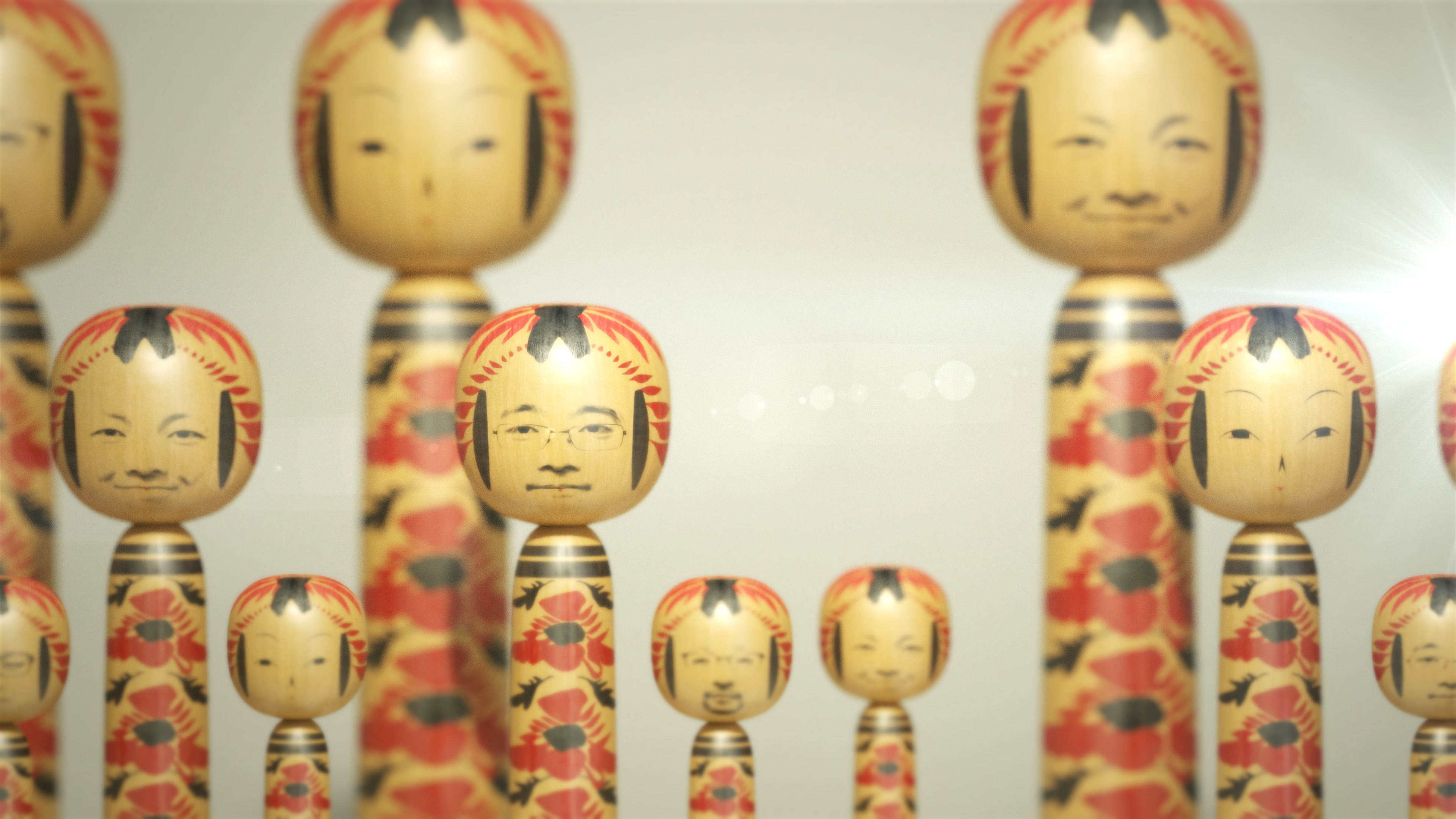 Faces projected on to kokeshi dolls as part of the POPPO exhibition at Japan House. Credit WOW.